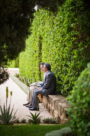 Two delegates sit in the gardens