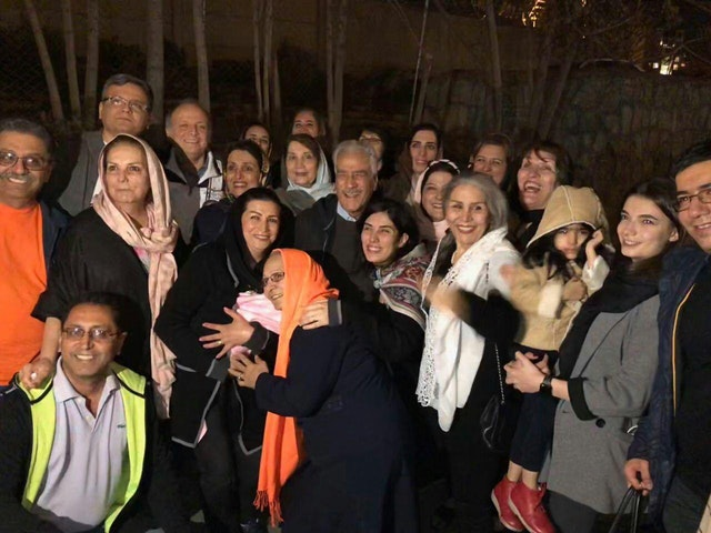 Jamaloddin Khanjani (center) reunited with friends and family