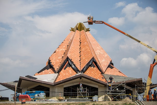 Workers put the crown at the top of the roof of the local House of Worship in Norte del Cauca, Colombia.