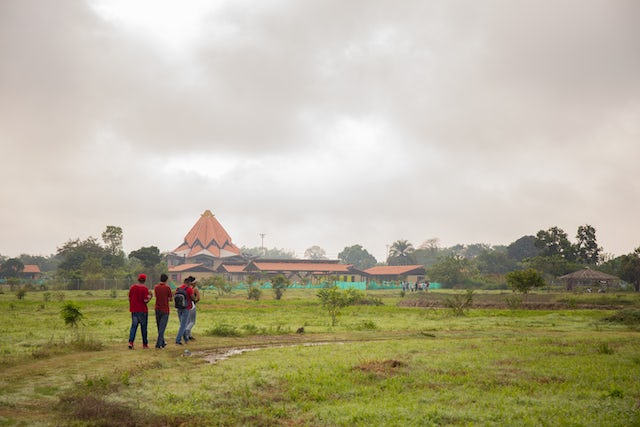 Members of the community walk in the grounds around the Temple. The land here has already become a haven for visitors to find peace, to meditate, and to enjoy the beauty of the natural habitat.