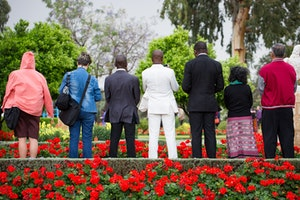 Delegates offer prayers in the gardens