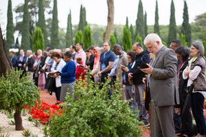 Delegates pray in the gardens