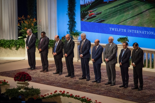 The members of the Universal House of Justice are, from left to right, Paul Lample, Chuungu Malitonga, Payman Mohajer, Shahriar Razavi, Stephen Hall, Ayman Rouhani, Stephen Birkland, Juan Mora, and Praveen Mallik. The House of Justice was elected by delegates to the 12th International Baha'i Convention in Haifa.