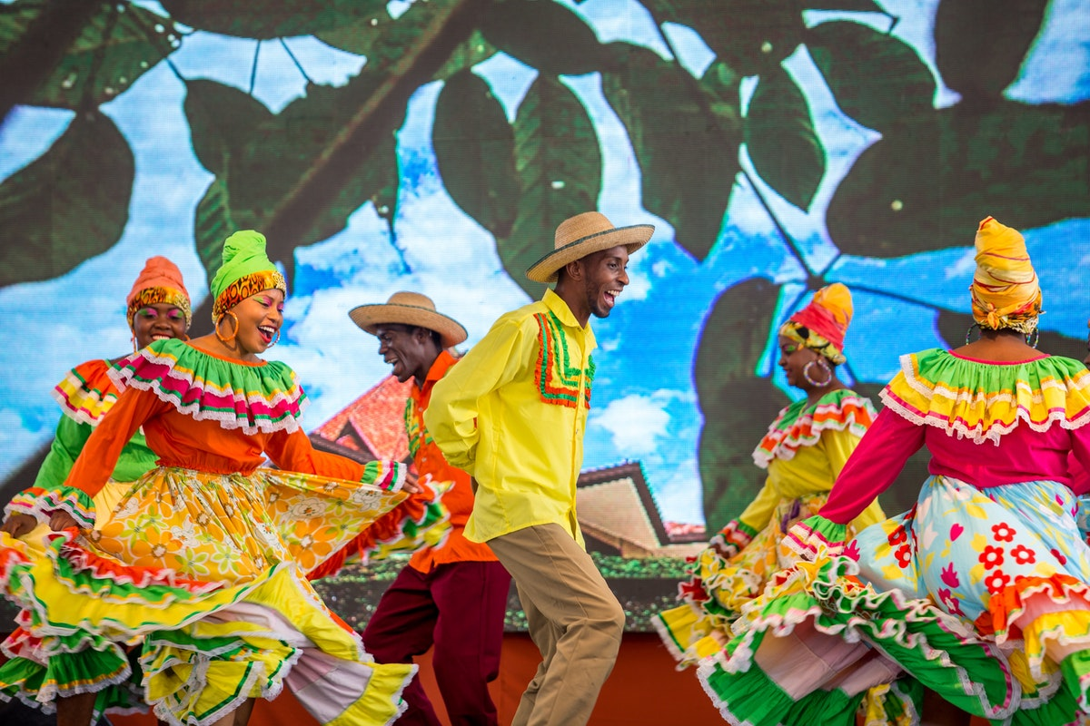 "A dance group performs to the song ""Alma Nortecaucana,"" meaning ""the Soul of Norte del Cauca,"" which is about the arrival of the Baha'i Faith in the region and how Baha'u'llah's teachings are given expression in the hopes and aspirations of the people"