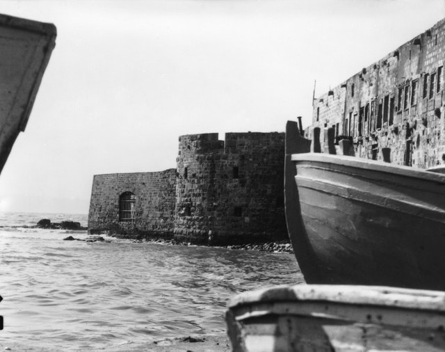 Baha'u'llah entered Akka on 31 August 1868 through the sea gate, which can be seen left of center along the sea wall. This photo, from 1920, shows what the sea gate would have looked like at the time of Baha'u'llah's arrival, with water running directly to the wall. Today, this area along the old sea wall is a paved promenade.