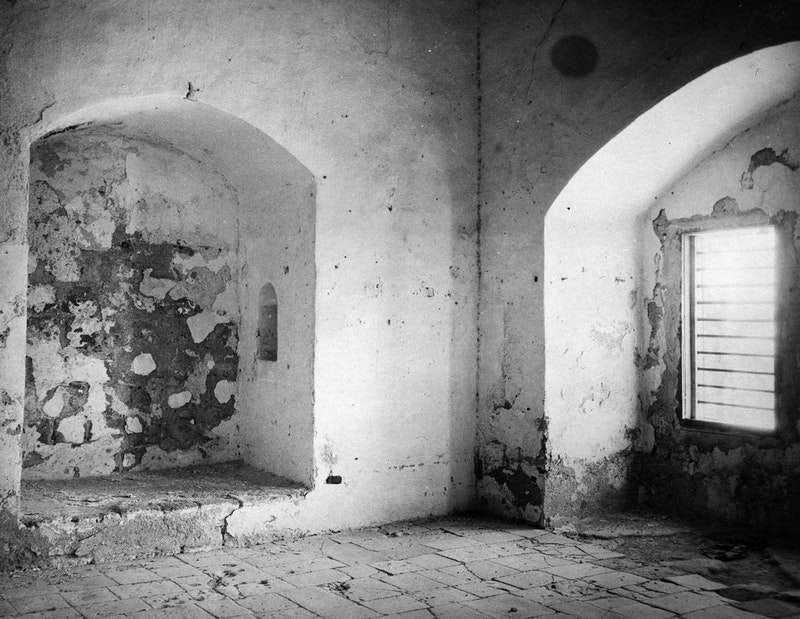 This 1921 photo shows the prison cell in which Baha'u'llah was kept for more than two years from 1868 to 1870. It was here where he revealed some of the messages to the kings and rulers of the world.