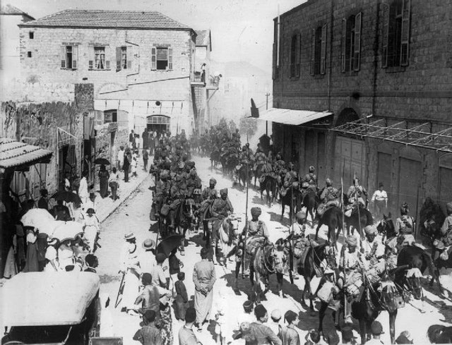 Indian lancers march through Haifa after it was captured from the Ottomans in September 1918 (Credit: British War Museum, accessed through Wikimedia Commons).