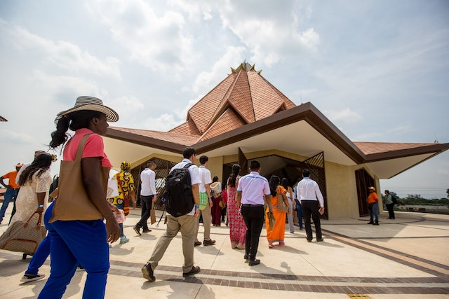 Participants enter the Colombia Temple for their first visit during the 22 July inauguration ceremony. Five groups of about 220 people each filled the Temple for a devotional program, which included prayers and readings from the Baha'i writings.