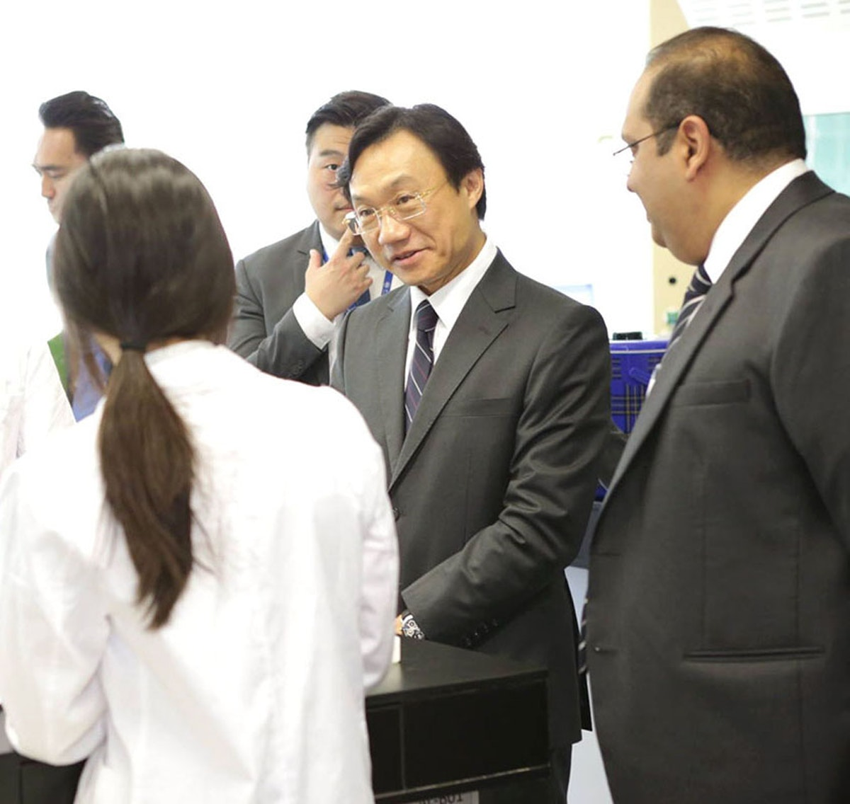 Alexis Tam, Macau's Secretary for Social Affairs and Culture, visited School of the Nations in April 2017. Here Dr. Tam (second from right) visits a high school science laboratory with Vivek Nair (right), the school's director.