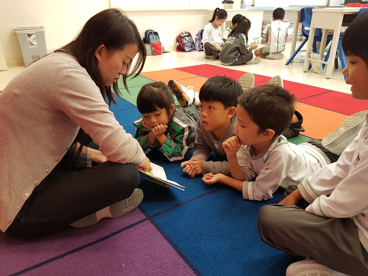 An elementary school teacher reads to her students.