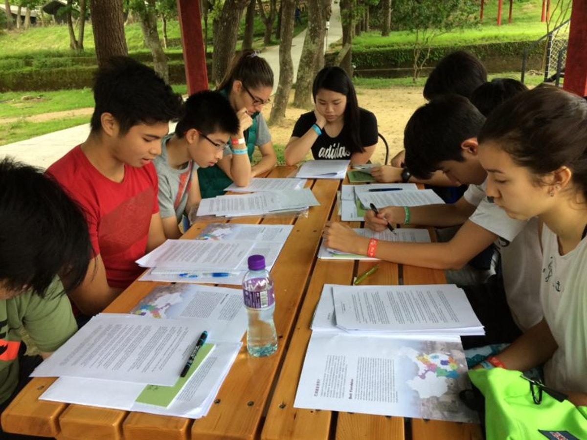 A high school teacher and several students study during a camp held in Hong Kong in May 2017.