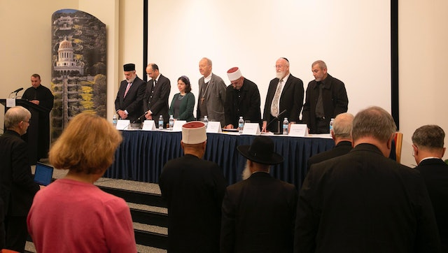 (From left) Emir Muhammad Sharif Odeh, Baha'i International Community Deputy Secretary-General Shervin Setareh, Rabbi Naama Dafni-Kelen, Bishop Michel Dubost, Sheikh Jaber Mansour, Sheikh Rashad Abo Alhigaa, and Father Yousef Yakoub spoke on a panel about nurturing a spirit of mutual tolerance and coexistence. Rabbi David Metzger, not pictured, also spoke on the panel.